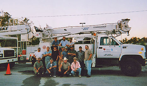 Several Northeast Texas Power employees take time from work to pose for a photo.