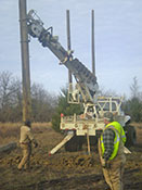 Northeast Texas Power crew installing electrical transmission poles