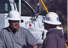 Northeast Texas Power crew consulting on a job
